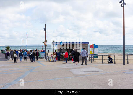 People out for a sunday afternoon walk along Bournemouth promenade on a chilly day in October 2018 - Stock Photo