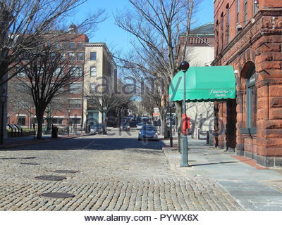 New Bedford, Massachusetts, USA - March 10, 2018: Cobblestone street on quiet winter morning in front of Freestone's City Grill in New Bedford - Stock Photo