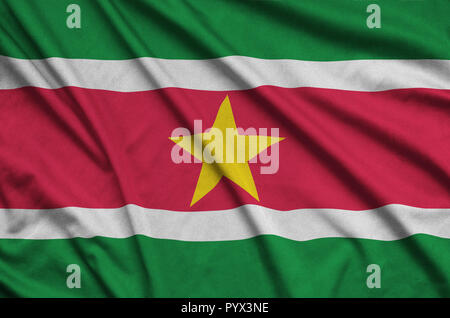 Suriname flag  is depicted on a sports cloth fabric with many folds. Sport team waving banner - Stock Photo