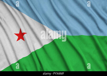 Djibouti flag  is depicted on a sports cloth fabric with many folds. Sport team waving banner - Stock Photo