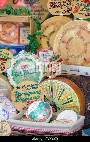 Different varieties of Continental cheeses on display and for sale in the Viktualienmarkt in Munich, Germany. - Stock Photo
