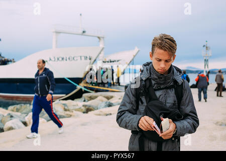 Ouranoupoli, GREECE - SEPTEMBER 23, 2014: pilgrims take a ferry to the holy mountain Athos - Stock Photo
