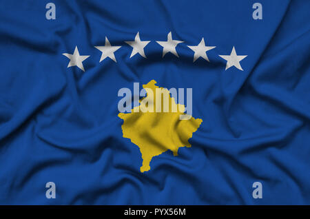 Kosovo flag  is depicted on a sports cloth fabric with many folds. Sport team waving banner - Stock Photo