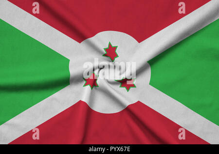 Burundi flag  is depicted on a sports cloth fabric with many folds. Sport team waving banner - Stock Photo