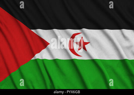 Western Sahara flag  is depicted on a sports cloth fabric with many folds. Sport team waving banner - Stock Photo