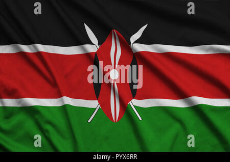 Kenya flag  is depicted on a sports cloth fabric with many folds. Sport team waving banner - Stock Photo