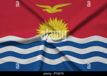 Kiribati flag  is depicted on a sports cloth fabric with many folds. Sport team waving banner - Stock Photo