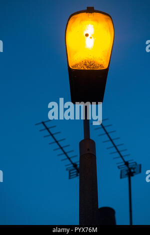Street lamp / light / lights / lamps of an older sodium technology, soon to be replaced by LEDs. (96) - Stock Photo