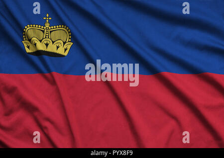 Liechtenstein flag  is depicted on a sports cloth fabric with many folds. Sport team waving banner - Stock Photo