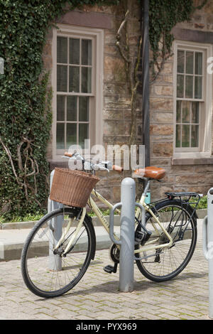 PRINCETON, NEW JERSEY - April 14, 2017: One of many bicycles parked on the Princeton University campus - Stock Photo