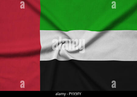 United Arab Emirates flag  is depicted on a sports cloth fabric with many folds. Sport team waving banner - Stock Photo