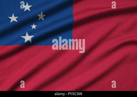Samoa flag  is depicted on a sports cloth fabric with many folds. Sport team waving banner - Stock Photo