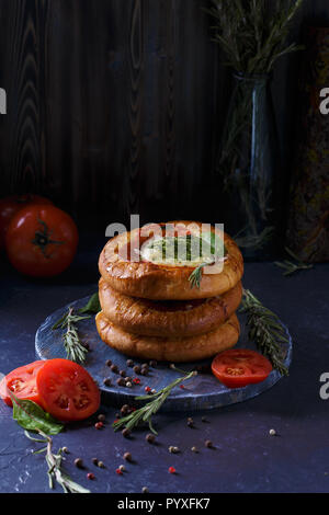 Three Homemade Mini Pizza with Tomatoes, Cheese and Bacon, Injuries and Spices on Light Blue Background Copy space Vertical - Stock Photo
