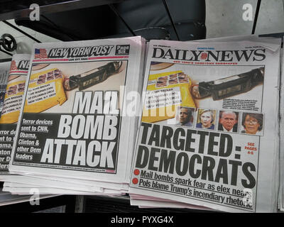 Headlines of the New York Daily News and Post newspapers use identical handout photographs on Thursday, October 25, 2018 to report on the makeshift pipe bombs that were mailed to various prominent Democrats. (© Richard B. Levine) - Stock Photo