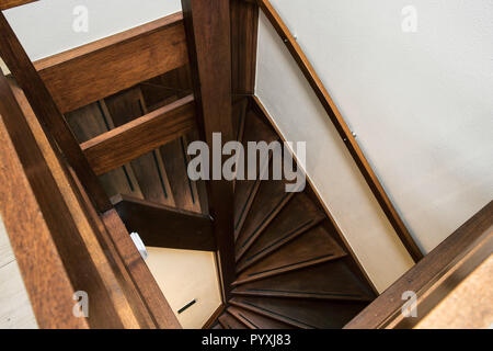 Modern brown oak wooden stairs in new renovated house interior - Stock Photo