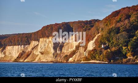 Baltic Sea coast with Rugen Island (Rugia, Ruegen) chalk cliffs at sunrise, Germany. - Stock Photo