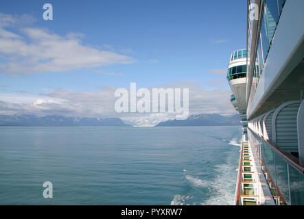 Cruise ship leaving Yakutat Bay, Alaska during an Inside Passage cruise, looking towards the stern from a balcony. - Stock Photo