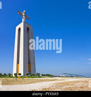 Cristo-Rei statue on the Cristo Rei or King Christ Sanctuary in Almada. The second most visited sanctuary in Portugal, and a landmark of Lisbon - Stock Photo