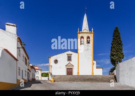 Igreja de Nossa Senhora da Conceicao Church. Mother Church of Crato with typical white washed walls and ochre or yellow color. Alto Alentejo, Portugal - Stock Photo