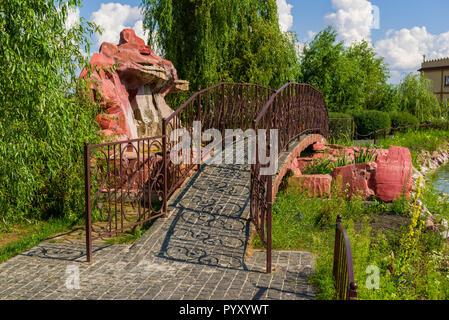 stone bridge with metal railings - Stock Photo