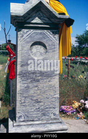 Grave marker for Wounded Knee Massacre victims, Pine Ridge Sioux Reservation, South Dakota. Photograph - Stock Photo