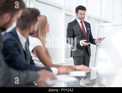 team leader giving presentation to his business colleagues - Stock Photo