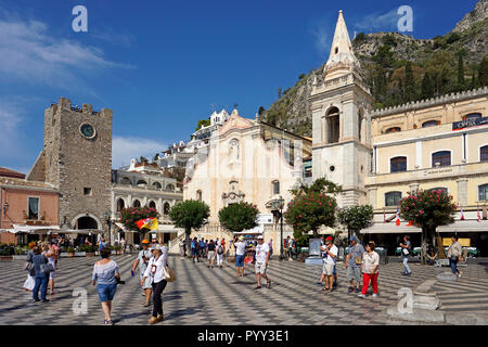 The church of San Giuseppe and the clock tower Torre dell'Orolorgio in Piazza IX. Aprile, old town of Taormina, Sicily, Italy - Stock Photo