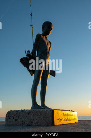"""The little fisherman""""- a bronze sculpture of a young boy and a large fish, by Paphos artist, Yiota Ioannidou. - Stock Photo"""