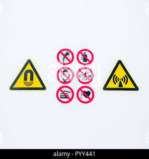 Isolated Warning caution signs at the entrance to the controlled radioactive area lightbox in hospital - Stock Photo
