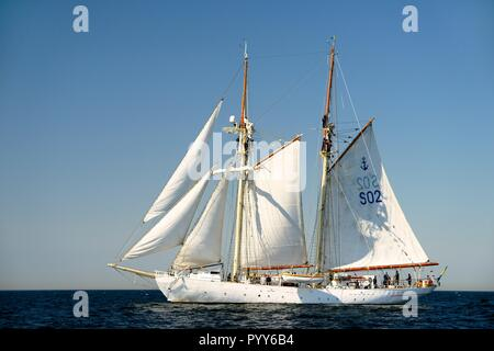 HSwMS Falken. Tall ship training schooner of the Swedish Navy under sail in the Baltic Sea. Crew aloft working sails during course tacking manoeuvre - Stock Photo