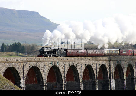 Stanier 8F preserved steam engine on Dalesman special train on 30th October 2018 crossing Ribblehead viaduct on Settle to Carlisle railway line. - Stock Photo