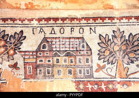 Ancient byzantine natural stone tile mosaics with house and orange trees, Madaba, Jordan - Stock Photo