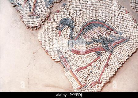 Ancient byzantine natural stone tile mosaics with heron, Madaba, Jordan - Stock Photo