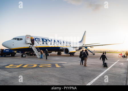 Dublin, Ireland - November 12, 2017: Passengers are boarding on Ryanair Boeing 737-800 airplane in the runaway of the Dublin Airport short before take - Stock Photo