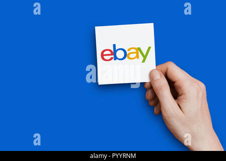 LONDON, UK - October 30th 2018: Hand holding Ebay logo. Ebay is an online marketplace - Stock Photo