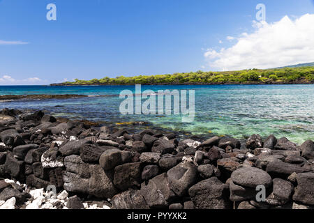 View of kealakekua bay on Hawaii's Big Island. Crystal clear blue-green water in the bay; coastline in the background - Stock Photo