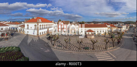 Alter do Chao, Portugal. Largo Barreto Caldeira Square with Alamo Palace in the left, bandstand and typical Portuguese cobblestone pavement - Stock Photo