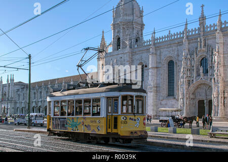 Tram 15 in front of the cloister Monastery of Jeronimos (Mosteiro dos Jeronimos) in the Belem district, Lisbon, Portugal. - Stock Photo