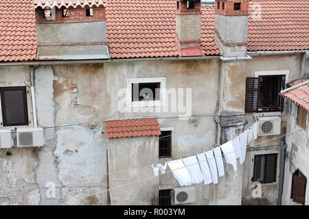 Backyard in the historic city of Pula in Croatia - Stock Photo