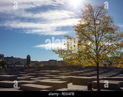 The Jewish Holocaust Memorial museum in Berlin, Germany, against a blue sky on a sunny day, wallpaper. - Stock Photo