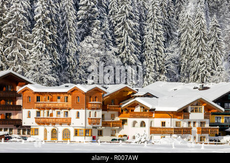 Snow covered hotels near a ski piste in the European Alps. Flachau, Austria - Stock Photo