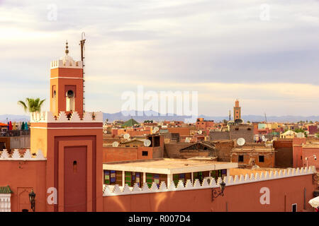 Minaret tower on the historical walled city (medina) in Marrakech. Morocco - Stock Photo