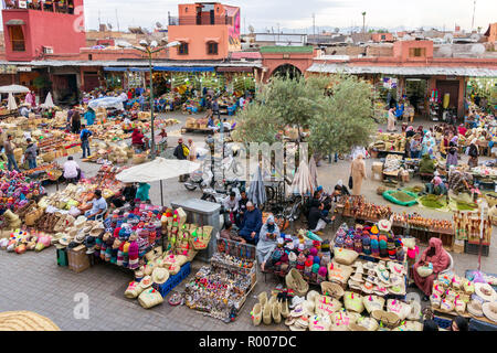 MARRAKESH, MOROCCO - APR 28, 2016: Local people selleing their goods at the berber market in the souks of Marrakech. - Stock Photo