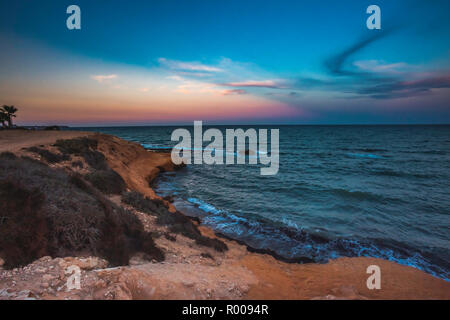 Landscape shot of Mil Palmeras seashore in the evening, Spain - Stock Photo