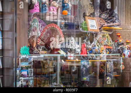 Toledo, Spain - April 28, 2018: Showcase of a souvenir shop in the historic center of the city on a spring day - Stock Photo