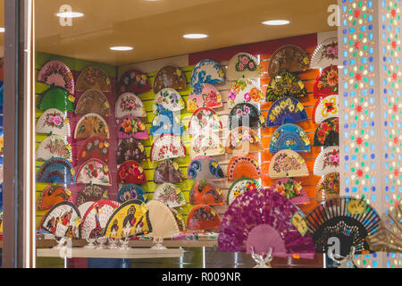 Toledo, Spain - April 28, 2018 - front of a multicolor fan shop in the historic center, symbol of Spanish culture - Stock Photo