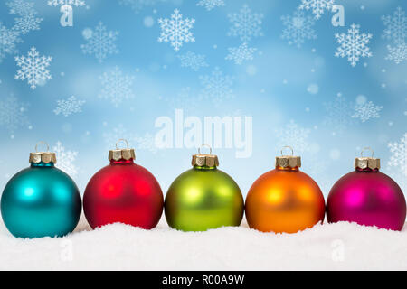 Many colorful Christmas balls baubles background decoration snowflakes snow winter copyspace - Stock Photo