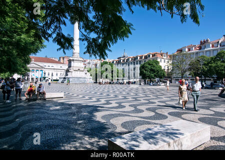 Rossio Square in the city center, Praca de Dom Pedro IV, in the Baixa district, Lisbon, Portugal. - Stock Photo