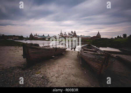 Two old wooden boats on the background of the Solovetsky Monastery, Russia - Stock Photo