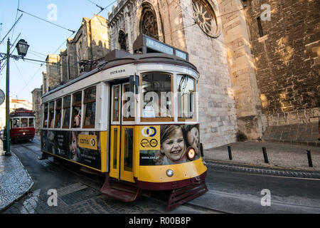 Tram 12 on the Rua Augusto Rosa in the Alfama district, Lisbon, Portugal. - Stock Photo